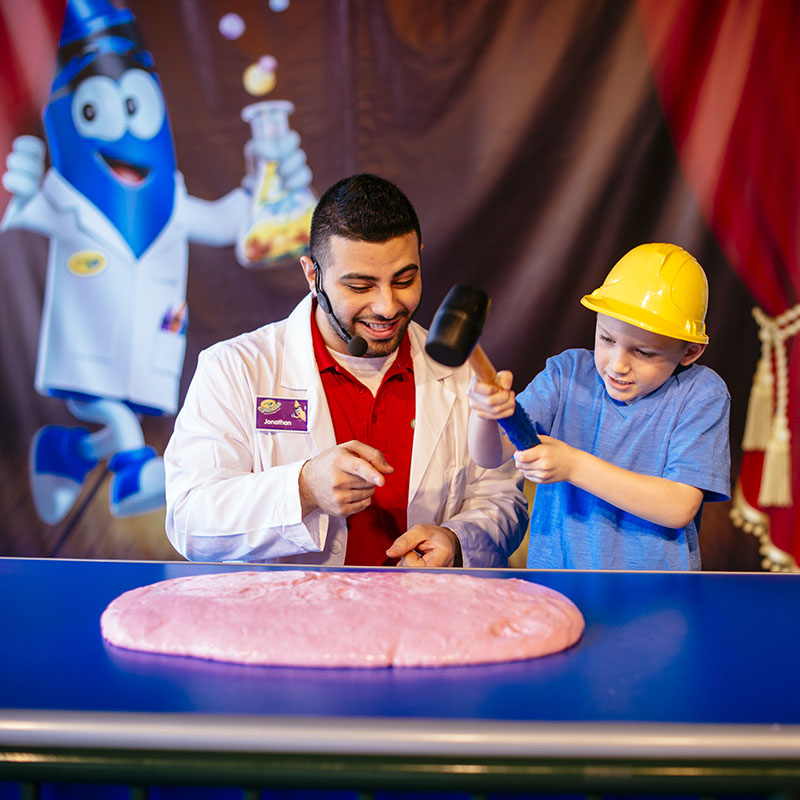 Child and presenter at Crayola Experience Cafe Show