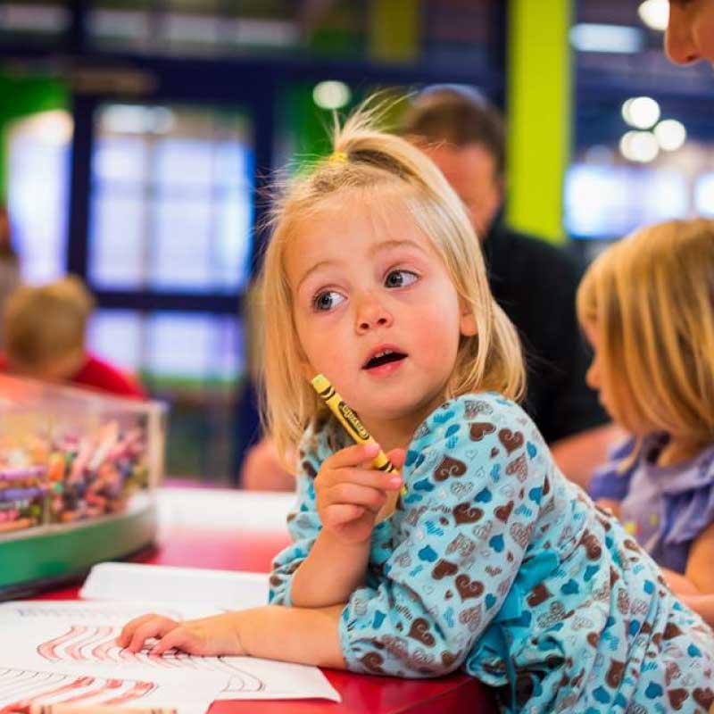 Girl toddler with crayon