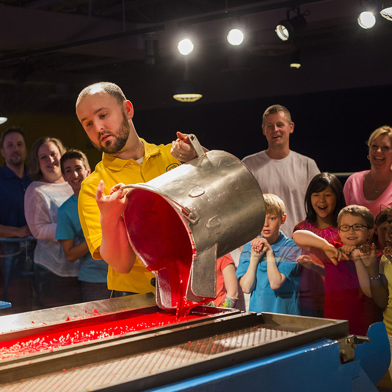 Families watching crayon wax being poured at Crayon Factory show at Crayola Experience