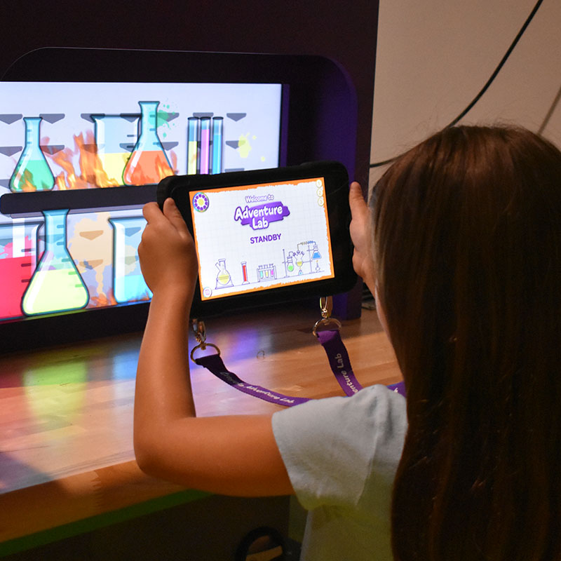Girl playing in Adventure Lab at Crayola Experience