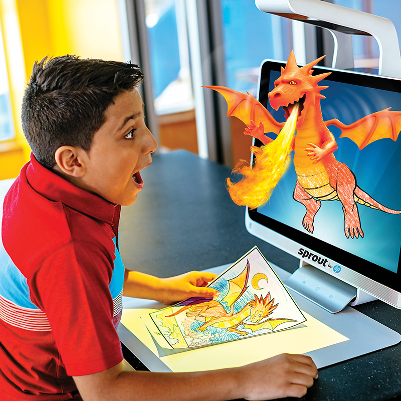 Boy with a dragon coming out of a computer screen at Color Magic at Crayola Experience