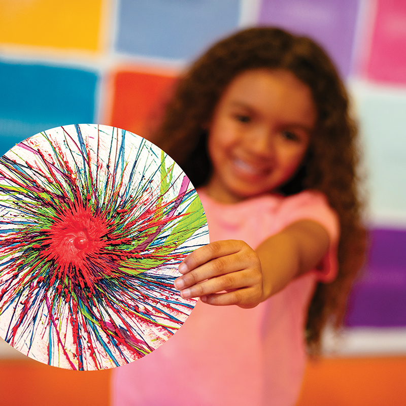Young girl holding Spin Art