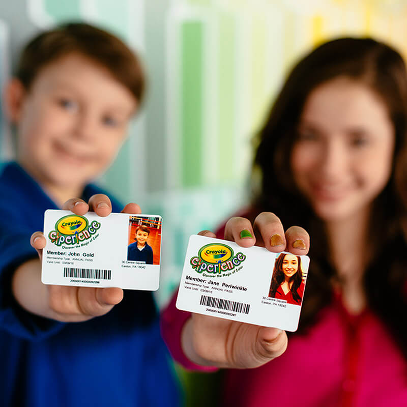 Children holding passes to Crayola Experience